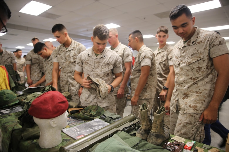 MARINE CORPS BASE CAMP PENDLETON, Calif. – Marines with 1st Combat Engineer Battalion, 1st Marine Division, looked at some of the tools used throughout the history of the Marine Corps during the unit's 75th anniversary celebration at Camp Pendleton May 27, 2016. On the second day, veterans were center stage as they presented themselves and their military experiences with the current personnel of 1st CEB. (U.S. Marine Corps photo by Cpl. Demetrius Morgan/RELEASED)
