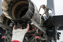 U.S. Air Force Tech. Sgt. Kevin Brown and Airman 1st Class Collin Blackburn, both aerospace propulsion technicians assigned to the 494th Aircraft Maintenance Unit out of Royal Air Force Lakenheath, England, guide an engine into place on an F-15E Strike Eagle dual-role fighter aircraft June 8, 2016, during RED FLAG-Alaska (RF-A) 16-2 at Eielson Air Force Base, Alaska. During RF-A, maintenance units work diligently to keep jets operational despite a high-operations tempo created by the simulated deployed environment, preparing U.S. and partner-nation forces for contingency operations. (U.S. Air Force photo by Capt. Elias Zani/Released)