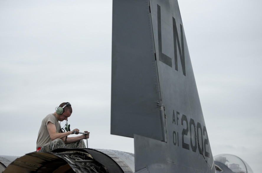 U.S. Air Force Airman 1st Class Collin Blackburn, an aerospace propulsion journeyman assigned to the 494th Aircraft Maintenance Unit out of Royal Air Force Lakenheath, England, uses a torque wrench to secure an engine into place on an F-15E Strike Eagle dual-role fighter aircraft June 8, 2016, during RED FLAG-Alaska (RF-A) 16-2 at Eielson Air Force Base, Alaska. Units from across the Department of Defense and partner nations send units to Eielson for RF-A to train for contingency operations in a controlled environment. (U.S. Air Force photo by Capt. Elias Zani/Released)