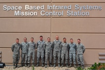 Space operators with the 2nd Space Warning Squadron pose for a photo outside the Space Based Infrared System Mission Control Station after the SBIRS Block 10 Ground System certification to operational status occurred on May 23, 2016, at Buckley Air Force Base, Colo. The system had previously been in the testing and evaluation phase since Oct. 2014, but now, the 460th Space Wing is flying operational mission satellites twenty four hours a day, seven days a week. (U.S Air Force photo by Lt. Col. April Wimmer/Released)
