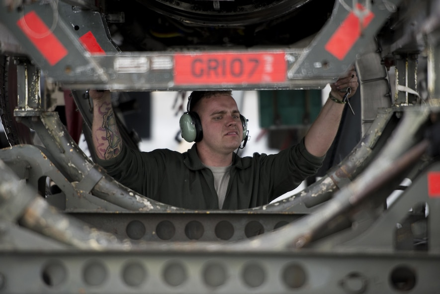 U.S. Air Force Senior Airman Christopher Strader, an aerospace propulsion journeyman assigned to the 494th Aircraft Maintenance Unit out of Royal Air Force Lakenheath, England, removes an engine guide cart from behind an F-15E Strike Eagle dual-role fighter aircraft so his team can better maneuver to secure an engine June 8, 2016, during RED FLAG-Alaska (RF-A) 16-2 at Eielson Air Force Base, Alaska. RF-A provides an opportunity for Airmen to work together alongside partner-nation forces to solve issues and keep jets operational while serving on a simulated deployment. (U.S. Air Force photo by Capt. Elias Zani/Released)