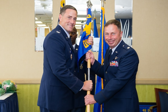 Col. Thomas G. Falzarano, 45th Operations Group commander, presents Lt. Col. Jason Havel, 45th Operations Group Detachment 3 with the guidon during a change of command ceremony June 10, 2016, at Patrick Air Force Base, Fla. Changes of command are a military tradition representing the transfer of responsibilities from the presiding officials to the upcoming official. (U.S. Air Force photos/Benjamin Thacker/Released)