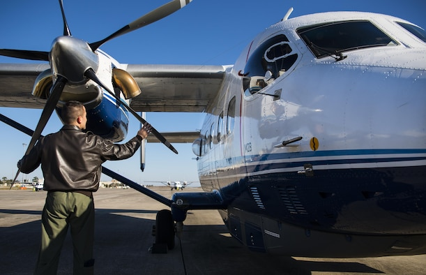 A loadmaster performs preflight checks on a C-145 Skytruck prior to an airdrop mission at Duke Field, Fla.  The Skytrucks are primarily used for new aircrew qualifications and flight proficiency missions.  (U.S. Air Force photo/Tech. Sgt. Sam King)