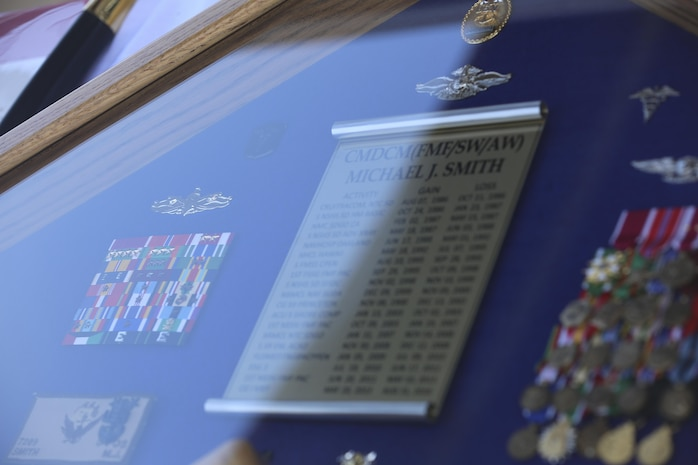 MARINE CORPS BASE CAMP PENDLETON, Calif. - The shadowbox of Master Chief Petty Officer Michael Smith, outgoing command master chief of I Marine Expeditionary Force, lies on display during his change of charge and retirement ceremony on Camp Pendleton, June 3, 2016. The shadowbox was a gift given to Smith by the Navy, which displays duty stations he served in, ribbons and medals he was awarded, and the insignias of the ranks he rose through. (U.S. Marine Corps Photo By Cpl. Garrett White/Released)