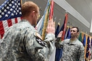 Sgt. Aaron Berogan, Public Affairs Specialist, 85th Support Command, recites the oath of enlistment during a reenlistment ceremony held at the command headquarters, June 4th, 2016.