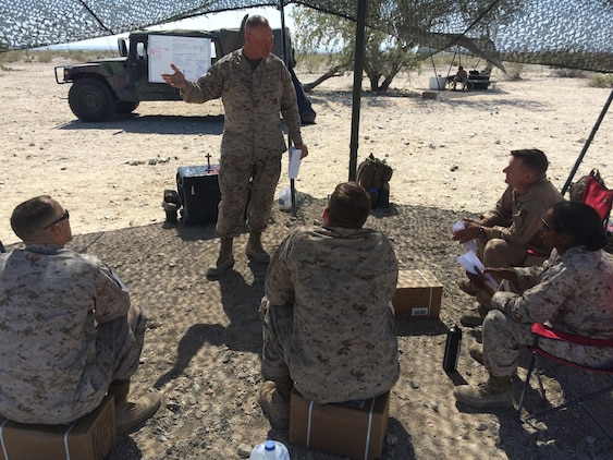 Lt. Cmdr. Paul Greer speaks to service members at a religous meeting during Weapons and Tactics Instructor Course 2-16 Field Exercises at Marine Corps Air Station Yuma, Ariz., March 27, 2016. Greer was recogized for the 2016 Military Chaplains Association Distinguished Service Award, and will recieve the award in Oct. 2016. The award recognizes one representative from each branch of service for their performance and dedication to the troops while serving as a chaplain. Greer is the chaplain for Marine Aircraft Control Group 28, and is the second 2nd MAW chaplain to win the award for the Marine Corps in the past two years. (U.S. Navy photo by Petty Officer 3rd Class Alexis McDaniel/Released)