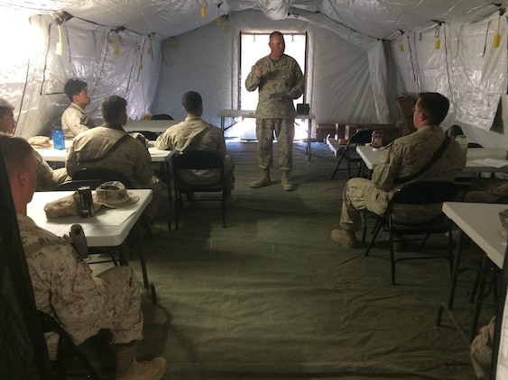 Lt. Cmdr. Paul Greer speaks to service members at a religous meeting during Weapons and Tactics Instructor Course 2-16 Field Exercise at Marine Corps Air Station Yuma, Ariz., March 27, 2016. Greer was recogized for the 2016 Military Chaplains Association Distinguished Service Award, and will recieve the award in Oct. 2016. The award recognizes one representative from each branch of service for their performance and dedication to the troops while serving as a chaplain. Greer is the chaplain for Marine Aircraft Control Group 28, and is the second 2nd MAW chaplain to win the award for the Marine Corps in the past two years. (U.S. Navy photo by Petty Officer 3rd Class Alexis McDaniel/Released)