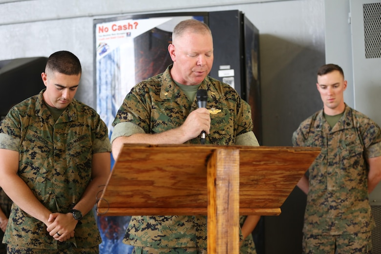 Lt. Cmdr. Paul Greer gives the invocation during a change of command ceremony at Marine Corps Air Station Cherry Point, N.C., June 6, 2016. Greer was recogized for the 2016 Military Chaplains Association Distinguished Service Award, and will recieve the award in Oct. 2016. The award recognizes one representative from each branch of service for their performance and dedication to the troops while serving as a chaplain. Greer is the chaplain for Marine Aircraft Control Group 28, and is the second 2nd MAW chaplain to win the award for the Marine Corps in the past two years. (U.S. Marine Corps photo by Lance Cpl. Mackenzie Gibson/Released)