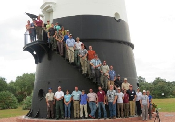 Members of the Gopher Tortoise Candidate Conservation Agreement team meeting pose for a photo at the Cape Canaveral Lighthouse at Cape Canaveral Air Force Station, Fla. June 7. The 45th Space Wing hosted the event here to show the group how they manage and protect gopher tortoise habitat on the Air Force's Eastern Range. Meeting participants from federal, state and the local agencies, as well other stakeholders are signing parties of the Candidate Conservation Agreement whose purpose to implement proactive gopher tortoise conservation measures across its eastern range which includes Florida, Georgia, Alabama and parts of South Carolina. (Courtesy photo)