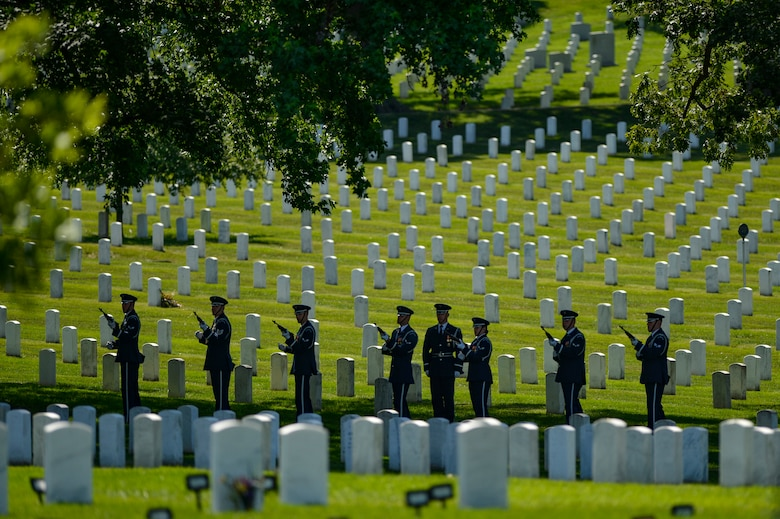 The U.S. Air Force Honor Guard performs a 21-gun salute during a graveside ceremony honoring former 2nd Lt. Malvin G. Whitfield, an Army Air Forces and Air Force veteran, at Arlington National Cemetery, Va., June 8, 2016. Whitfield joined the Army Air Forces in 1943 as a Tuskegee Airman, one of more than 1,000 African-American pilots who fought in World War II. (U.S. Air Force photo/Tech. Sgt. Joshua L. DeMotts)