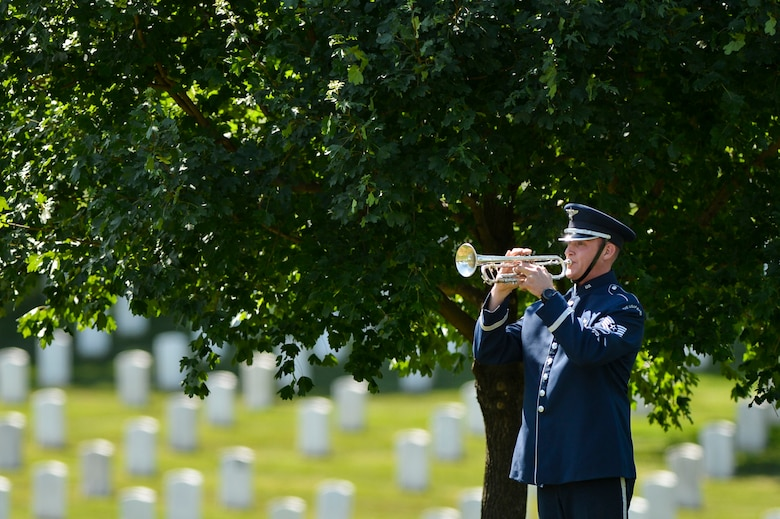 Tech. Sgt. Nathan Clark plays taps during a graveside ceremony honoring former 2nd Lt. Malvin G. Whitfield, an Army Air Forces and Air Force veteran, at Arlington National Cemetery, Va., June 8, 2016. In 1955, Whitfield was appointed by the educational exchange program in the Department of State to tour Europe, the Middle East and Africa as a sports goodwill ambassador. He died Nov. 19, 2015, at the age of 91. (U.S. Air Force photo/Tech. Sgt. Joshua L. DeMotts)