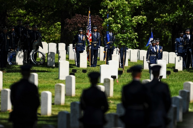 Members of the U.S. Air Force Honor Guard provide full honors for former 2nd Lt. Malvin G. Whitfield, an Army Air Forces and Air Force veteran, at Arlington National Cemetery, Va., June 8, 2016. (U.S. Air Force photo/Tech. Sgt. Bryan Franks)