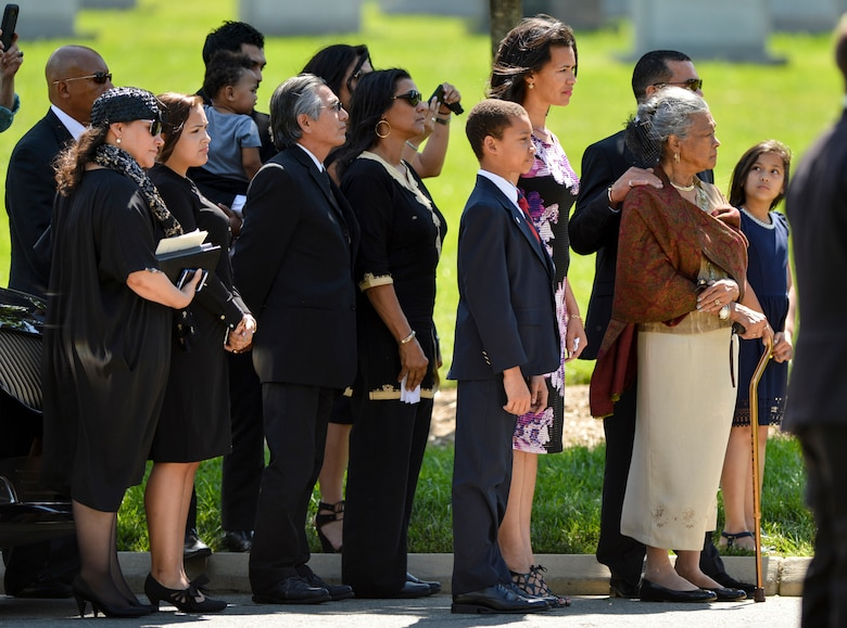 The family of former 2nd Lt. Malvin G. Whitfield watch as Whitfield's casket arrives at his burial site in Arlington National Cemetery in Arlington, Va., on June 8, 2016. While serving in the Korean War, Whitfield prepared to compete in track and field events at the 1951 Pan American Games by training on the runways between bombing missions.  (U.S. Air Force photo/Tech. Sgt. Joshua L. DeMotts)