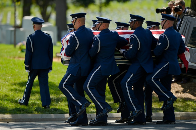 U.S. Air Force Honor Guard pallbearers carry former 2nd Lt. Malvin G. Whitfield, an Army Air Corps and Air Force veteran, to his burial site at Arlington National Cemetery in Arlington, Va., on June 8, 2016. Whitfield became the first active-duty U.S. military member to win gold medals in international track and field competitions when he competed at the 1948 Olympic Games in London, and in the 1951 Pan American Games. He died on Nov. 19, 2015, at the age of 91. (U.S. Air Force photo/Tech. Sgt. Joshua L. DeMotts)