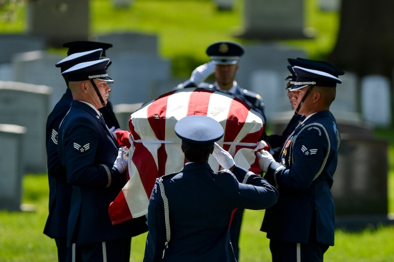 Members of the U.S. Air Force Honor Guard pay their final respects to former 2nd Lt. Malvin G. Whitfield during a graveside ceremony at Arlington National Cemetery in Arlington, Va., on June 8, 2016. Whitfield joined the Army Air Forces in 1943 as a Tuskegee Airman, one of more than 1,000 African-American pilots who fought in World War II. (U.S. Air Force photo/Tech. Sgt. Joshua L. DeMotts)