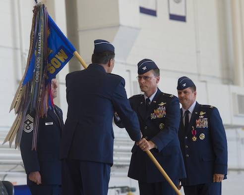 Col. Tom Palenske, commander of the 1st Special Operations Wing, takes the guidon from Lt. Gen. Brad Heithold, commander of Air Force Special Operations Command, to assume command of the 1st SOW during a change of command ceremony at Hurlburt Field, Fla., June 10, 2016. Upon taking command of the 1st SOW, Palenske will be responsible for preparing Air Force special operations forces for missions worldwide in support of Army, Navy, Marine and allied special operations forces and USAF counterparts. (U.S. Air Force photo by Airman 1st Class Kai White)