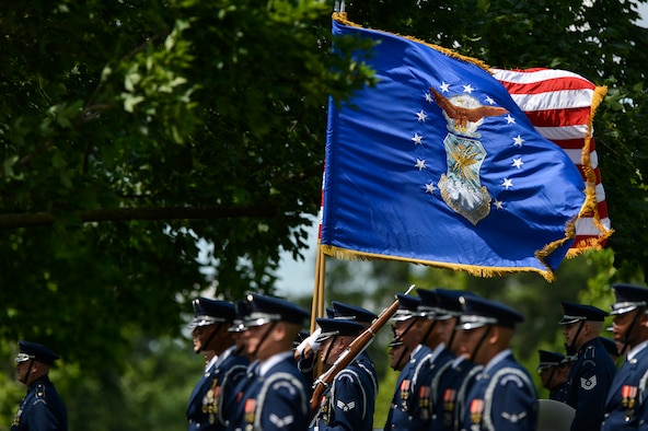 Members of the U. S. Air Force Honor Guard stand at attention during the graveside ceremony for 2nd Lt. Malvin G. Whitfield, Army Air Forces and Air Force veteran, at Arlington National Cemetery, June 8, 2016. Whitfield joined the Army Air Forces in 1943 as a Tuskegee Airman, one of the more than 1,000 African-American pilots who fought in World War II. He died Nov. 19, 2015, at the age of 91. (U.S. Air Force Photo by Tech. Sgt. Joshua L. DeMotts/Released)
