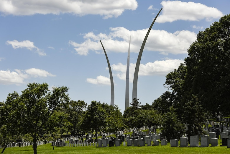 The Air Force Memorial is seen in the background as former 2nd Lt. Malvin G. Whitfield, 91, was laid to rest at Arlington National Cemetery, Va., June 8, 2016. In 1943, Whitfield enlisted in the Army Air Forces as a Tuskegee Airman, and later joined the Air Force Reserve as an officer. He died Nov. 19, 2015, at the age of 91. (U.S. Air Force photo/Staff Sgt. Alyssa C. Gibson)