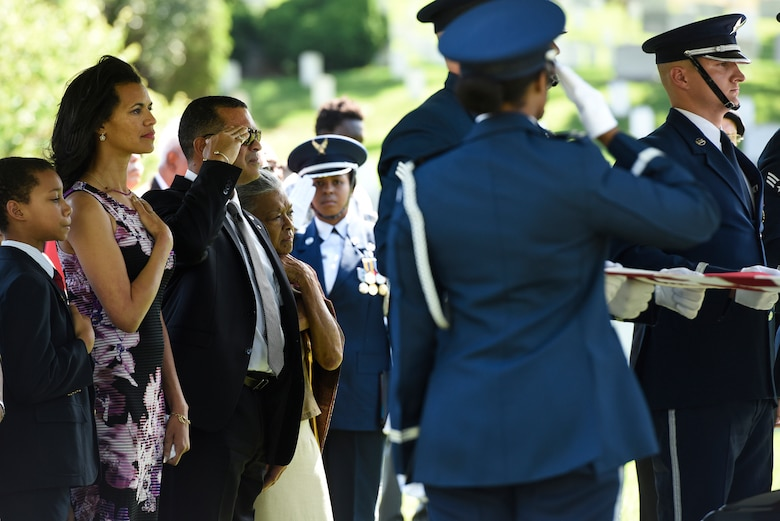 The family of former 2nd Lt. Malvin G. Whitfield, an Army Air Forces and Air Force veteran, stands during the playing of taps at Whitfield's graveside ceremony at the Arlington National Cemetery, Va., June 8, 2016. He died Nov. 19, 2015, at the age of 91. (U.S. Air Force photo/Staff Sgt. Alyssa C. Gibson)