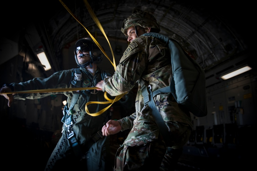 Staff Sgt. Will Favalora, 437 Airlift Wing loadmaster, assists 1st Lt. Jonathan Dieckman, 82nd Airborne Division jumpmaster, as he pulls parachute lines back into the aircraft following an airdrop into Poland as part of Exercise Swift Response June 6, 2016. Swift Response will exercise U.S. and Allied airborne forces' ability to operate together as a high-readiness team. U.S. military forces routinely train alongside Allies and partners in Europe. These training events help to build a Europe that is strong, whole, free and at peace. (U.S. Air Force photo/Staff Sgt. William A. O'Brien) (U.S. Air Force photo/Staff Sgt. William A. O'Brien)