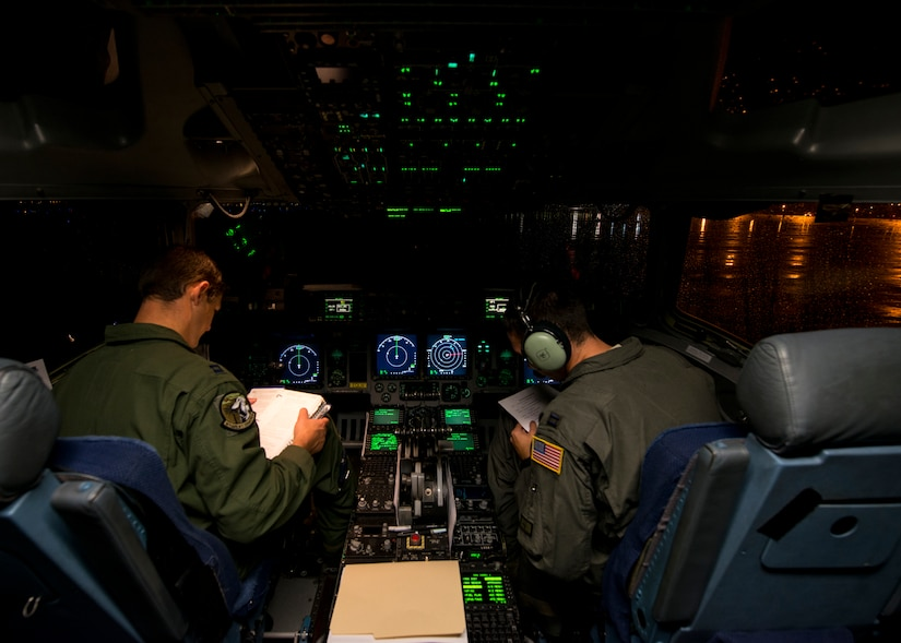 Capt. Chad Eva (left) and Capt. Chris Fleming (right), 437th Airlift Wing pilots, prepare for takeoff prior to an airlift as part of Exercise Swift Response June 6, 2016. Aircraft from across the Air Mobility Command provided airlift and air refueling capabilities for the exercise. The exercise tested U.S. and allied airborne forces' ability to operate together as a high-readiness team (U.S. Air Force photo/Staff Sgt. William A. O'Brien)