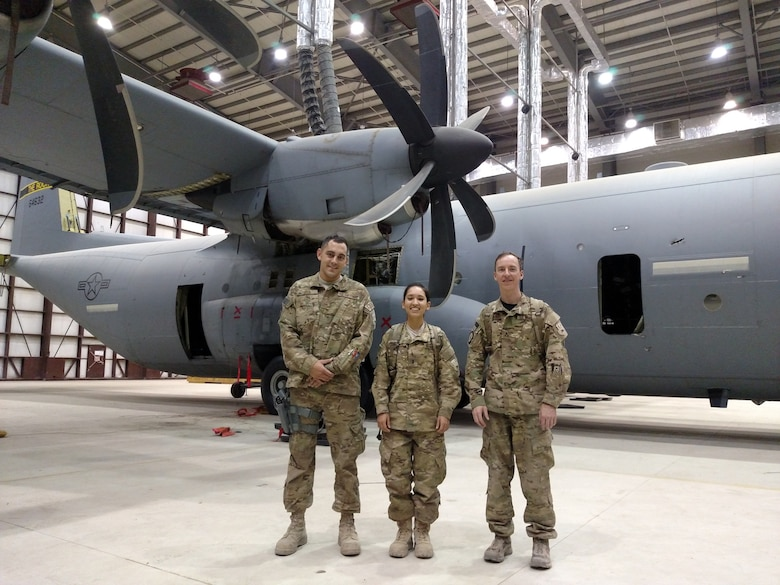 Experts from the Air Force Life Cycle Management Center's Mobility Directorate pause for a break. The team was deployed to Afghanistan to help repair a C-130J aircraft that had been severely damaged by enemy fire. From left, Tech. Sgt. Nicholas Ellis, 1st Lt. Alexis Sanchez and Joel Lechene. (Courtesy photo)