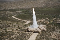 A guided multiple launch rocket system (GMLRS) rocket is launched from a High-Mobility Artillery Rocket System, mounted on a truck, during exercise Iron Rage at McGregor Range, N.M. Saturday. The rocket went just under 30 km, impacting about 5 meters from the target.