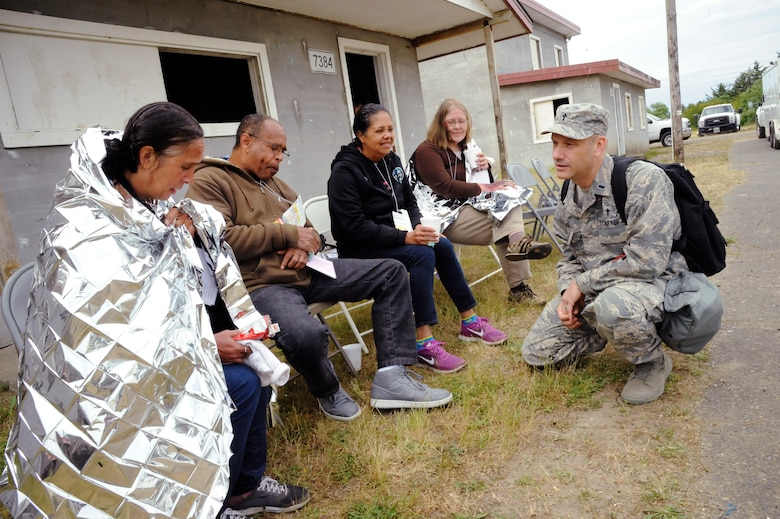 Oregon Air National Guard Chaplain Bob Edwards spends time listening to victims who survived a tsunami during the Cascadia Rising exercise at Camp Rilea, Warrenton, Ore., June 9, 2016. Cascadia Rising scenario is a 9.0 magnitude earthquake along the Cascadia Subduction Zone (CSZ) resulting in a tsunami, testing first responders, emergency management and public safety officials in the Pacific Northwest. (U.S. Air National Guard photo by Tech. Sgt. John Hughel, 142nd Fighter Wing Public Affairs/Released)