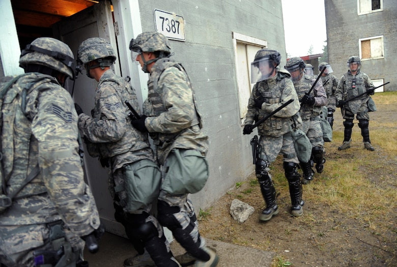Oregon Air National Guard Security Force members from the 142nd Fighter Wing and 173rd Fighter Wing train together as they conduct security search operations at Camp Rilea training village, Warrenton, Ore., during the Cascadia Rising exercise, June, 10, 2016. Cascadia Rising scenario is a 9.0 magnitude earthquake along the Cascadia Subduction Zone (CSZ) resulting in a tsunami, testing first responders, emergency management and public safety officials in the Pacific Northwest. (U.S. Air National Guard photo by Tech. Sgt. John Hughel, 142nd Fighter Wing Public Affairs/Released)
