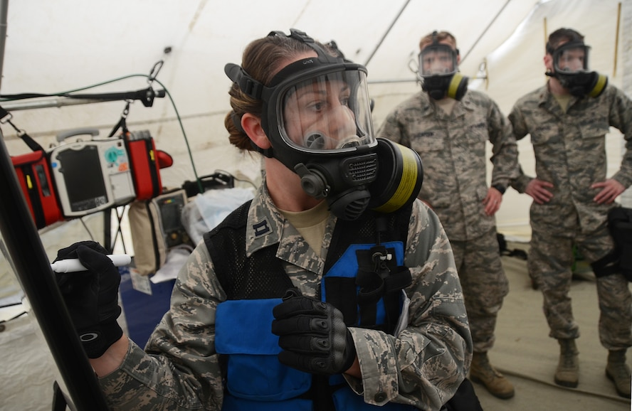 Kentucky Air National Guard Capt. Angela Himler, 123rd AW, records members of the Oregon and Kentucky joint CERFP team after a gas attack at Camp Rilea, during the Cascadia Rising exercise, Warrenton, Ore., June 8, 2016. Cascadia Rising scenario is a 9.0 magnitude earthquake along the Cascadia Subduction Zone (CSZ) resulting in a tsunami, testing first responders, emergency management and public safety officials in the Pacific Northwest. (U.S. Air National Guard photo by Tech. Sgt. John Hughel, 142nd Fighter Wing Public Affairs/Released)