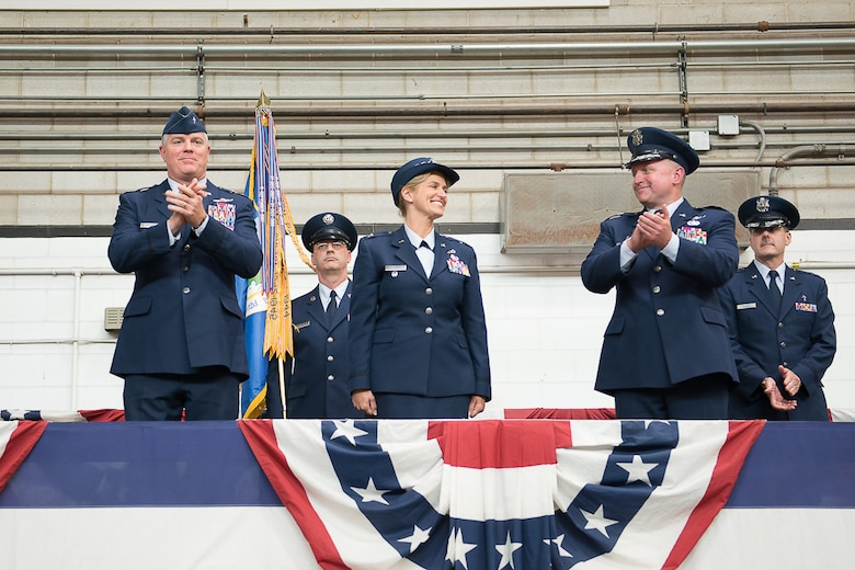 Colonel Virginia Doonan, center, became commander of the 102nd Intelligence Wing during a Change of Command ceremony today. Doonan succeeded Brig. Gen. James LeFavor, right, who served as commander since 2013. Presiding over the event was Brig. Gen. Robert Brooks, commander of the Massachusetts Air National Guard, pictured left. (U.S. Air National Guard photo by Tech. Sgt. Kerri Spero/Released)