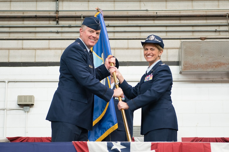 Col. Virginia I. Doonan accepts the 102nd Intelligence Wing guidon from Brig. Gen. Robert T. Brooks Jr., Commander, Massachusetts Air National Guard. Doonan became the commander of the 102nd Intelligence Wing on Friday, succeeding Brig. Gen. James M. LeFavor, who had served as commander since Nov. 2013. (U.S. Air National Guard photo by Tech. Sgt. Kerri Spero/Released)