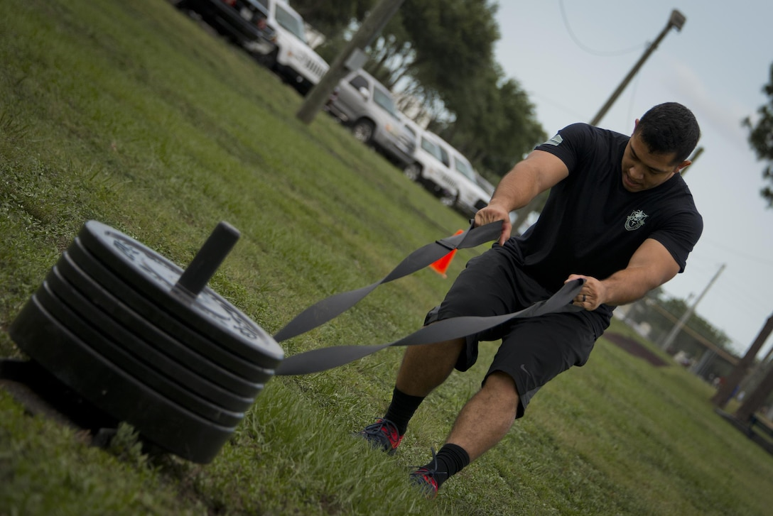 Spc. Jose Castillo, 7th Special Forces Group, pulls a weighted sled toward the finish line during a team combat fit competition June 11 at Duke Field, Fla.  The three-round competition pushed the teams to their limits with repetitive weight lifting, rowing, sled-pulling and other kinetic activities.  (U.S. Air Force photo/Tech. Sgt. Sam King)