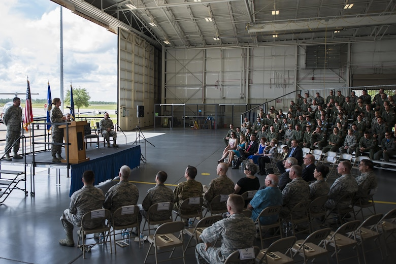 Col. Regina Sabric addresses her new group at the 919th Special Operations Group's change of command ceremony June 12 at Duke Field, Fla.  Sabric was stationed at the Pentagon before becoming the first female commander of the group.  U.S. Air Force photo/Tech. Sgt. Sam King)