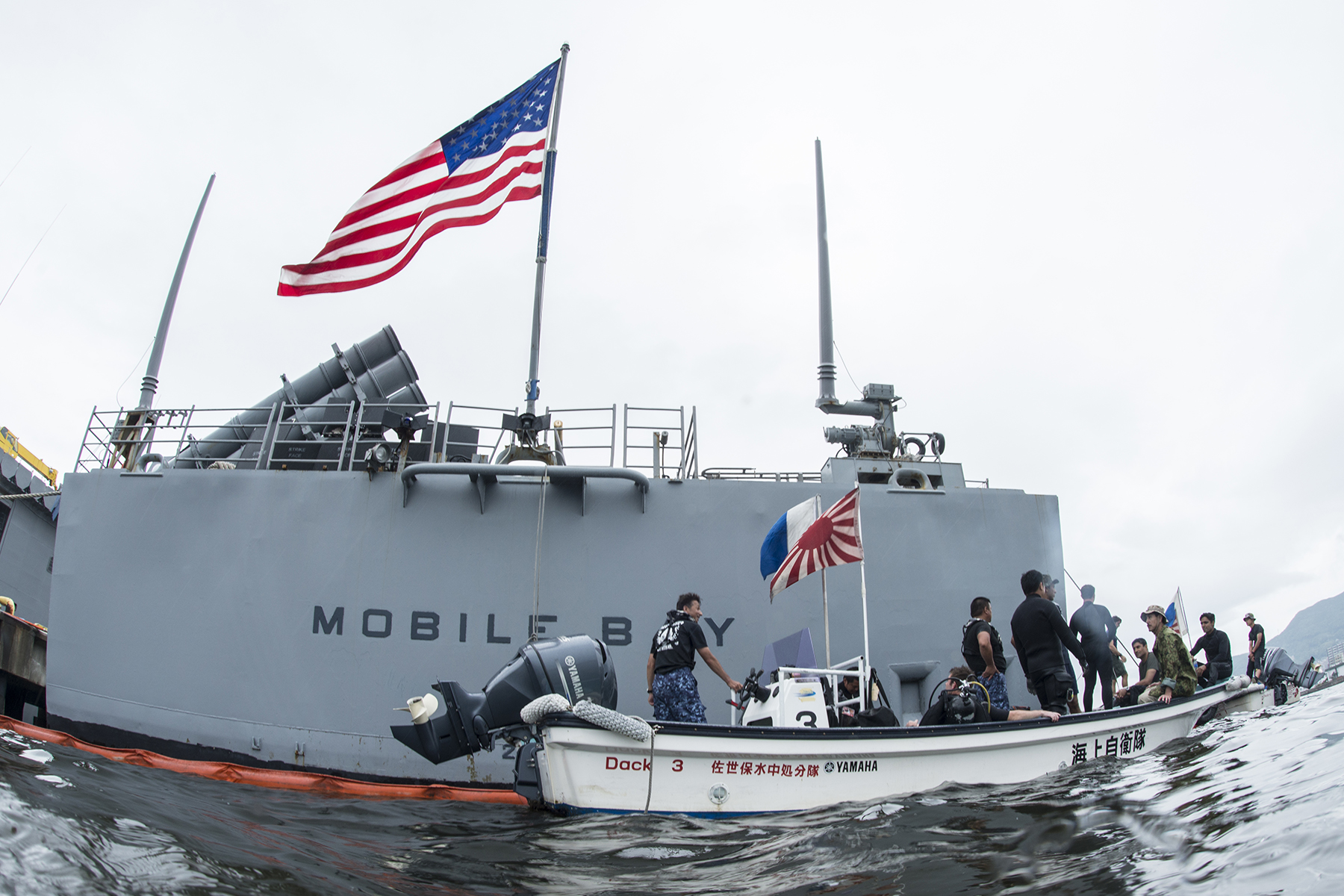 Explosive ordnance disposal technicians from the Indian Navy, Japan Maritime Self-Defense Force and U.S. Navy on a small boat