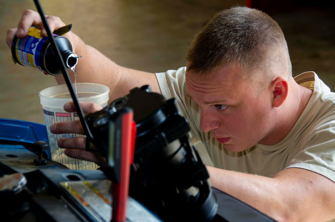Tech. Sgt. Chad Bennett and Staff Sgt. Wade Spradlin, Vehicle Maintainers from the 117th Logistical Readiness Squadron at the 117th Air Refueling Wing, replace a broken air compressor inside a security forces truck June 11, 2016 in Birmingham, Ala. (Air National Guard photo by Senior Airman Wes Jones/Released)