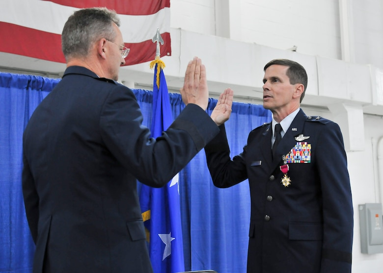 New York Air National Guard Brig. Gen. Greg Semmel (right) reaffirms his oath of office with Maj. Gen. Anthony German (left), the Adjutant General of the State of New York, during his promotion ceremony held on Hancock Field in Syracuse, NY Friday, June 10. Semmel will now serve as Assistant Adjutant General – Air for the New York Air National Guard. (U.S. Air National Guard photo by Tech. Sgt. Jeremy M. Call/Released)