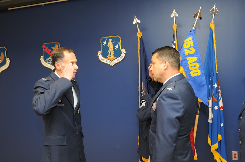 New York Air National Guard Col. Brian VanKouwenberg (right) salutes Col. Michael Comella (left) as he formally assumes command of the 152nd Air Operations Group, during an assumption-of-command ceremony at Hancock Field in Syracuse, NY Saturday, June 11. (U.S. Air National Guard photo by Tech. Sgt. Justin A. Huett/Released)