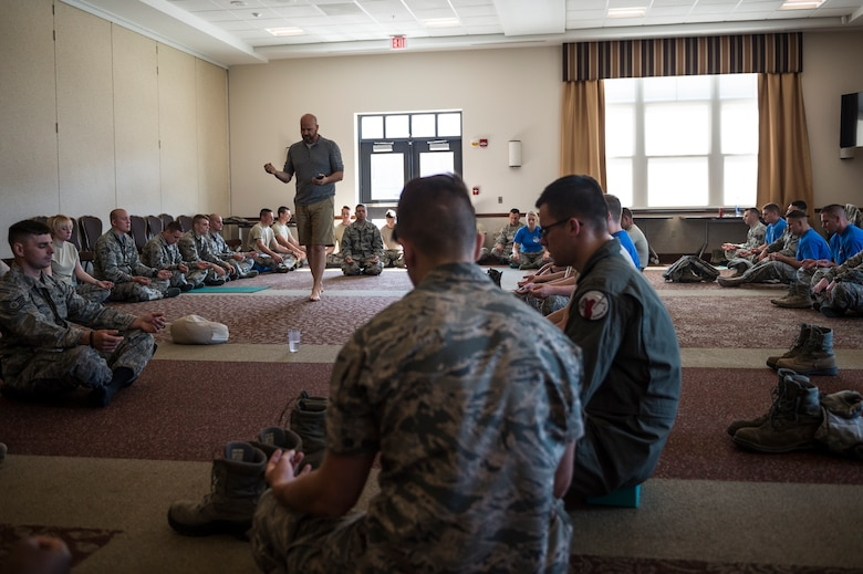 Airmen from the 107th Airlift Wing participate in a meditation class given by Soma Cura as part of Wellness Week at Niagara Falls Air Reserve Station, June 10, 2016. Soma Cura, a local wellness center, was on base offering introductory classes to mediation as well as yoga, as part of the various classes taking part during Wellness Week. (U.S. Air National Guard photo by Staff Sgt. Ryan Campbell/released)