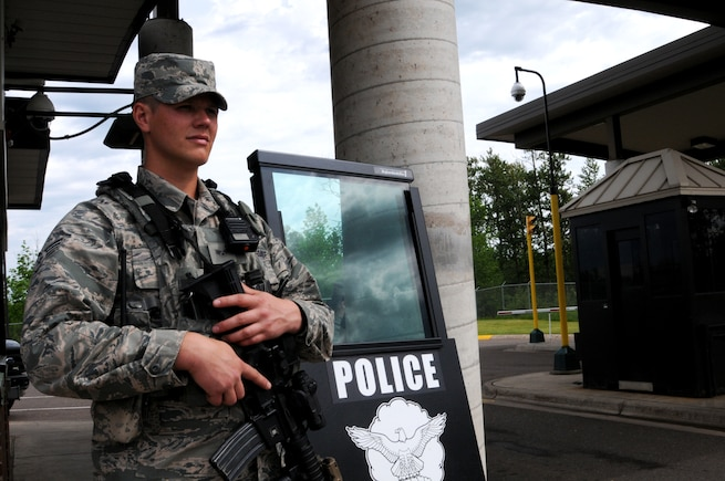 148th Fighter Wing Security Forces member, Senior Airman Tyler J. Carlson, poses for a photo at the front gate to the 148th Fighter Wing, Duluth, Minn. June 12, 2016.  A Duluth native, Carlson ensures the safety of base personnel and facilities, a task he takes great pride in. (U.S. Air National Guard Photo by Tech. Sgt. Scott G. Herrington)