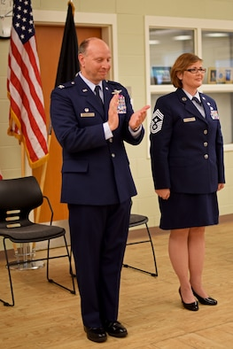 U.S. Air Force Col. Mark Auer (left), 121st Air Refueling Wing commander, and Chief Master Sgt. Kelly Gibbs (right), command chief, take part in an assumption of command ceremony on June 11, 2016, Rickenbacker Air National Guard Base, Ohio. As the unit's newest command chief, Chief Master Sgt. Gibbs is responsible for advising the commander on matters of mission effectiveness; readiness; training and the health, morale and welfare of all 121 ARW enlisted members. (U.S. Air National Guard photo by Senior Airman Wendy Kuhn/Released)