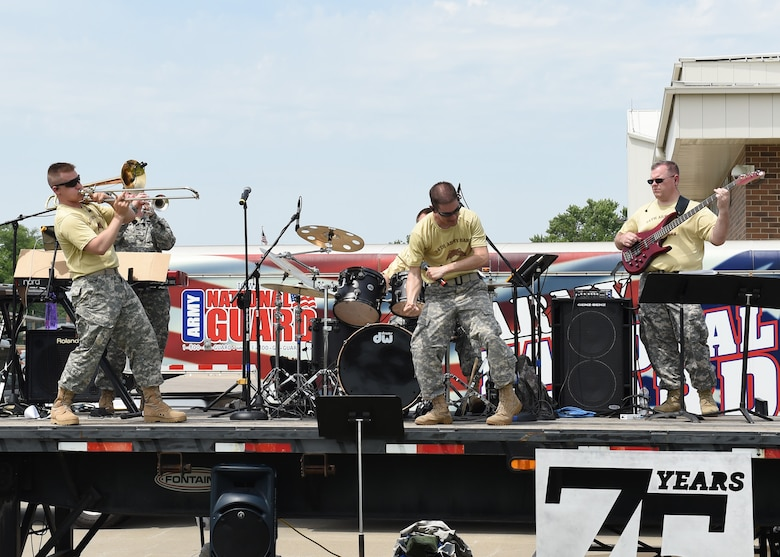 Current members and alumni of the 132d Wing participate in the wing's 75th Anniversary celebration June 11, 2016, at the 132d Wing in Des Moines, Iowa. The celebration featured aircraft displays, bouncey houses, The Sidewinders Army Band and numerous vendors. (U.S. Air National Guard photo by Staff Sgt. Michael J. Kelly/Released)