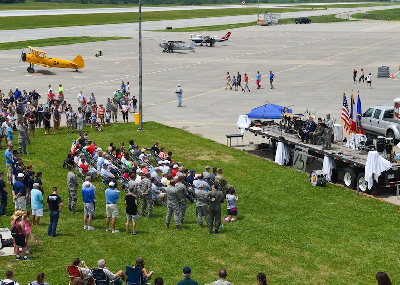Current members and alumni of the 132d Wing participate in the wing's 75th Anniversary celebration June 11, 2016, at the 132d Wing in Des Moines, Iowa. The celebration featured aircraft displays, bouncey houses, the Army band Sidewinders and numerous vendors. (U.S. Air National Guard photo by Staff Sgt. Michael J. Kelly/Released)
