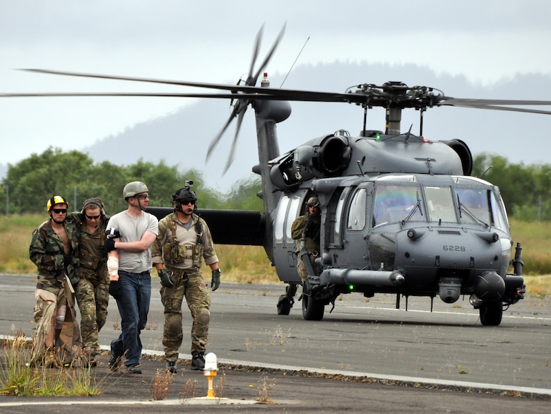 Pararescuemen from the 304th Rescue Squadron, Portland Air National Guard Base, Ore., exit an HH-60G Pave Hawk helicopter from the 305th Rescue Squadron, Davis-Monthan Air Force Base, Ariz., with fellow 304th reservists simulating casualties June 8, 2016 at the airport in Astoria, Ore. Several 304th personnel, plus Air and Army National Guardsmen and other local, state and federal government and civilian organizations participated in Cascadia Rising, a disaster response exercise simulating a magnitude 9.0 earthquake and subsequent tsunami in the Pacific Northwest. (U.S. Air Force photo by 1st Lt. Anna-Marie Wyant)