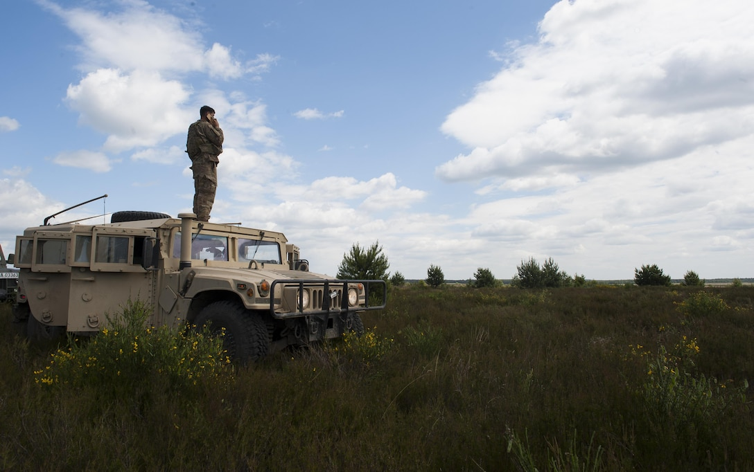 U.S. Air Force Staff Sgt. Thad Taylor, 15th Air Space Operations Squadron joint terminal attack controller, scouts the landscape as he participates in Exercise Anakonda 2016 June 10, 2016, at Poland. Exercise Anakonda 2016 is a Polish-led exercise, involving several nations, with over 25,000 participants from more than 20 countries. (U.S. Air Force photo/Airman 1st Class Lane T. Plummer)