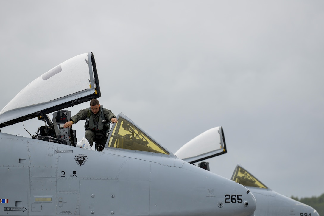 A pilot from the 107th Fighter Squadron, Selfridge Air National Guard Base, Michigan, exits an A-10C Thunderbolt II at Lielvarde Air Base, Latvia June 11, 2016. U.S. armed forces and Latvian airmen will participate in Saber Strike 16; a long-standing, U.S. Joint Chiefs of Staff-directed, U.S. Army Europe-led cooperative-training exercise, which has been conducted annually since 2010.  (U.S. Air Force photo/Senior Airman Nicole Keim)