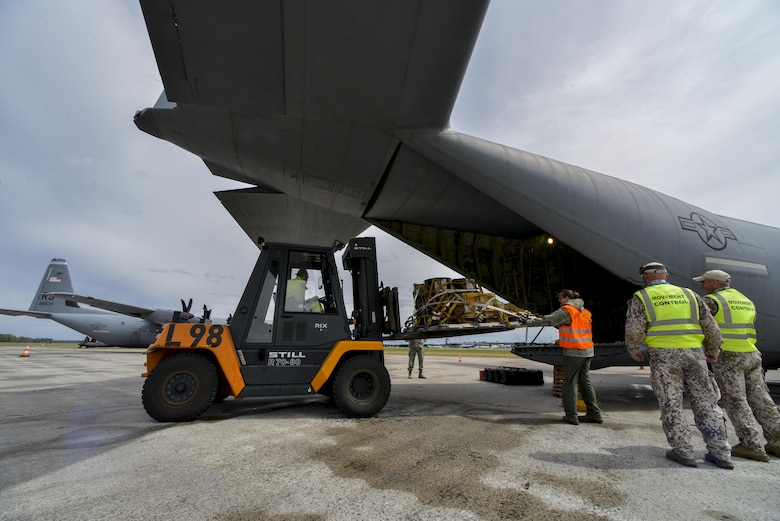 U.S. Airmen from the 37th Airlift Squadron, Ramstein, Germany, and Latvian airmen load cargo onto a C-130J Super Hercules June 10, 2016, at Riga Airport, Latvia.  U.S. forces are in Europe participating in Saber Strike 16; a long-standing, U.S. Joint Chiefs of Staff-directed, U.S. Army Europe-led cooperative-training exercise, which has been conducted annually since 2010. (U.S. Air Force photo/Senior Airman Nicole Keim)