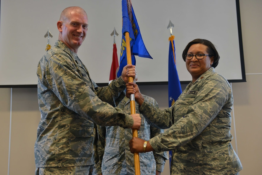 U.S. Air Force Maj. Yalunda Akinloba, 39th Contracting Squadron incoming commander, receives command from U.S. Air Force Col. John Walker, 39th Air Base Wing commander, June 13, 2016, at Incirlik Air Base, Turkey. Prior to taking command, Akinloba was the lead contracting officer, developmental systems contracts, rapid capabilities office, Headquarters U.S. Air Force, Washington D.C. (U.S. Air Force photo by Senior Airman John Nieves Camacho/Released)