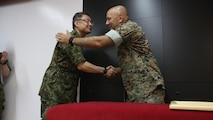U.S. Marine Col. Eric M. Mellinger, right, shakes hands with Japanese Ground Self-Defense Force Col. Shusei Hotta, June 13, 2016, at Camp Courtney, Okinawa, Japan. Mellinger received a Defense Cooperation Medal from Gen. Kiyofumi Iwata for significantly contributing to increasing training opportunities for the JGSDF by advancing co-use of Marine Corps training facilities on Okinawa and expanding III Marine Expeditionary Force efforts to participate in alliance/bilateral exercises. Hotta is the deputy chief of Policy and Programs Division, Ground Staff Office, JGSDF. Iwata is the JGSDF chief of staff. Mellinger is III MEF chief of staff.