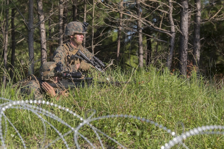 Private First Class Casin Mullinex and Lance Cpl. Shaun Carnley, machine gunners with 3rd Battalion, 6th Marine Regiment, set up defensive security after capturing Landing Zone Cardinal from the enemy during the final raid of the Marine Corps Combat Readiness Evaluation at Camp Lejeune, N.C., June 9, 2016. The MCCRE tests the Marines on their ability to operate as a whole and is the final exercise as a battalion during pre-deployment training.